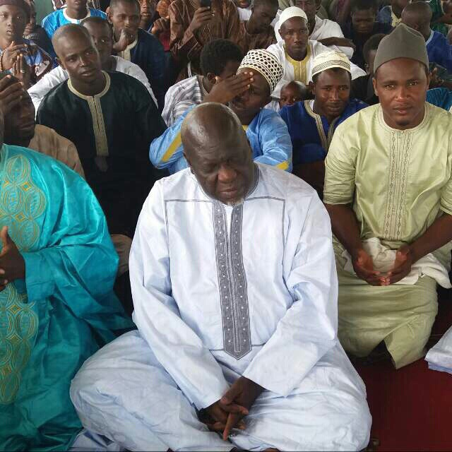 Spiritualist Danso praying with other